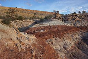 Orange, tan, and white layered badlands rocks