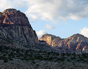 The last rays of light illuminate the peaks of Rainbow Mountain and Bridge Mountain.