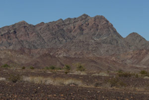 The desert is totally lacking in greenery.  The mountains look like somber brown sentinels.