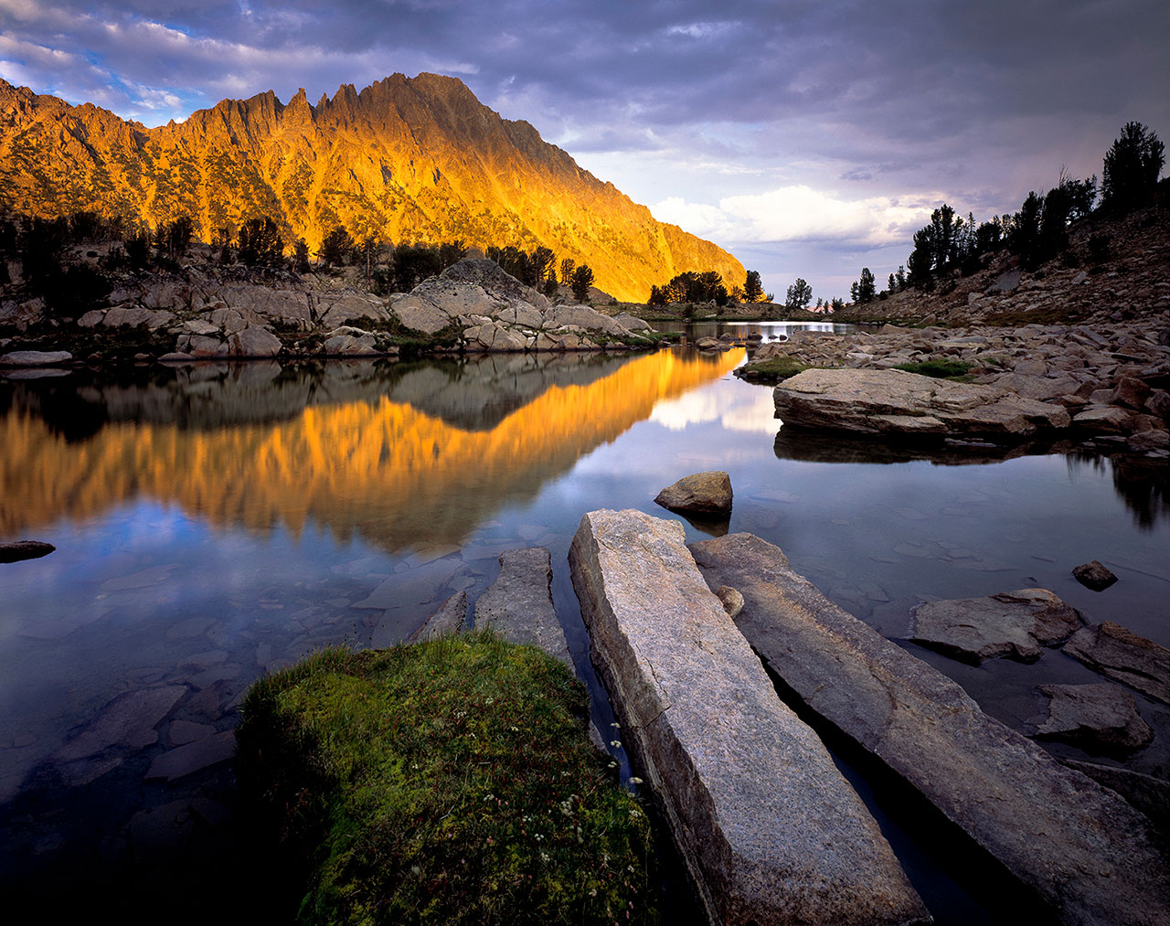 Mountains with a lake at sunset