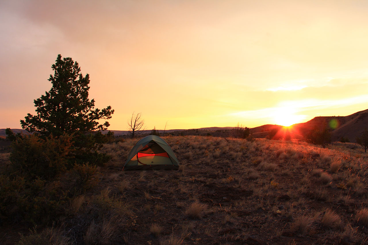 A tent at sunset