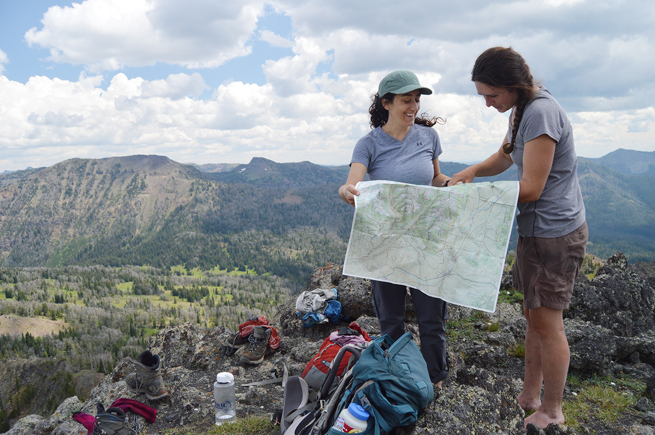 Women looking at a wilderness map