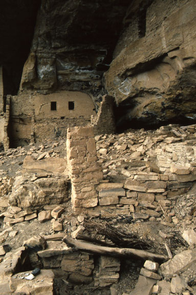The exterior of Spring House is littered with primitive bricks and deterioating structures.