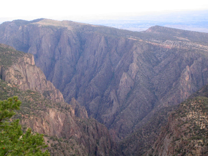 A look into the jagged depths of the Black Canyon, slicing through the desert landscape.