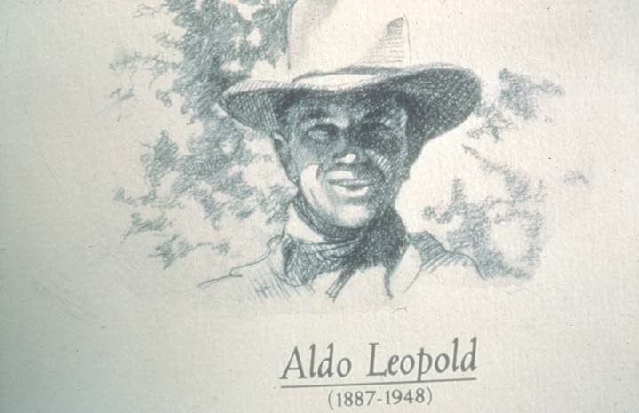 A black and white drawing of a man in a cowboy hat.
