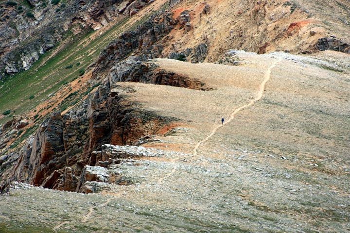 An aerial shot of a person walking along a trail atop one of the peaks in the Collegiate Peaks Wilderness Area.