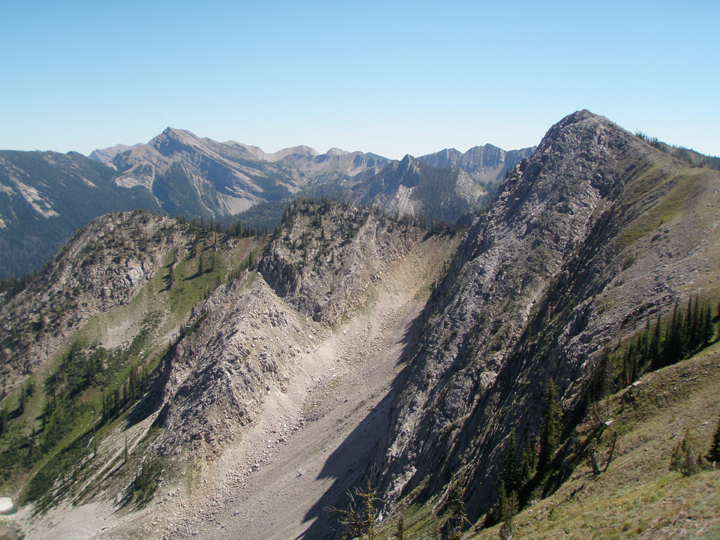Large mountain peaks rise up from steep rocky slopes.