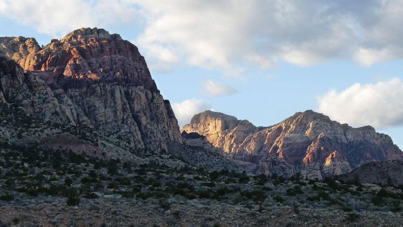 The last rays of light illuminate the peaks of Rainbow Mountain and Bridge Mountain.