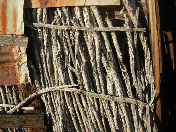 Unique wall construction using ocotillo branches - the historic home of the last Tohono O'Odam to live on the refuge. This area is now an archealogical site. Taken inside the eastern region of the Cabeza Prieta National Wildlife Refuge.