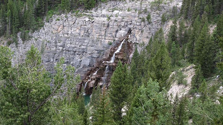 A waterfall cascades down a rocky cliff