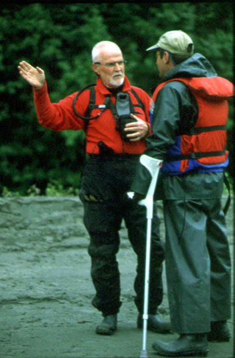 To men, one with crutches, wearing lifevests talk about their trip.
