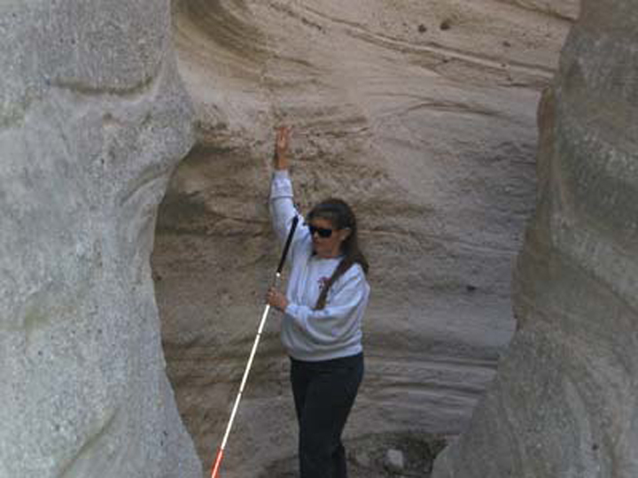 A blind hiker feels the shape of the canyon walls.