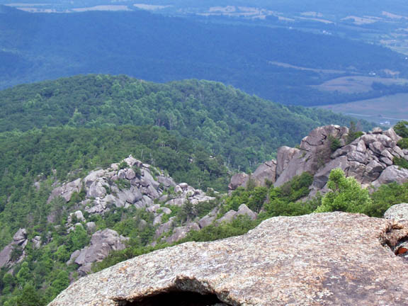 Another shot from atop Old Rag Mountain captures the grey boulder outcroppings and green trees near the base of the mountain.