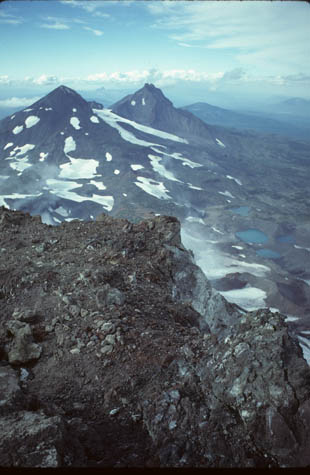 A shot from the South Sister in Deschutes National forest captures (presumably) the other two sister peaks that consist mostly of rocks and patches of snow.