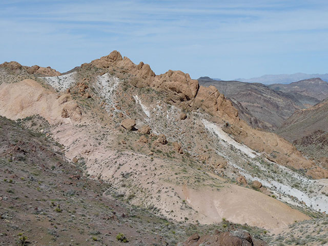 A colorful and intricate web of peaks, gentle slopes of lava flows, and craggy cliffs.