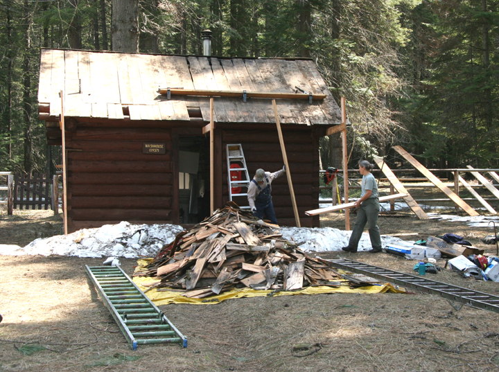 Historic Preservation Team stripping the roof off the bathhouse at Moose Creek for replacement.
