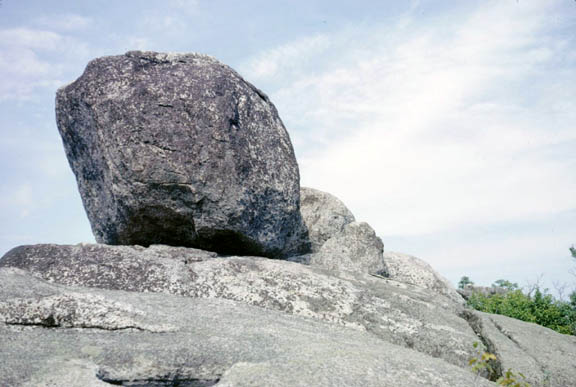 A giant boulder in the Old Rag Mountain area contrasts its grey color against the blue sky.