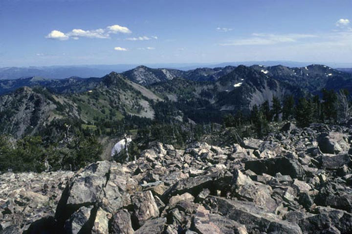 This view of the Six Lakes Basin and Seven Devils Mountain captures the mountain tops and patches of coniferious trees.
