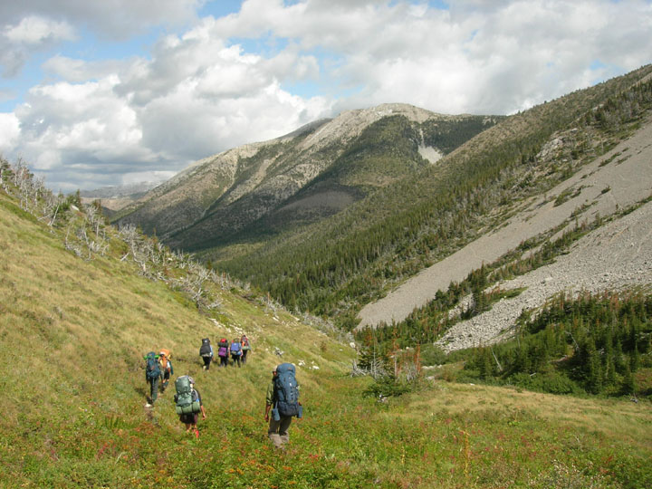 Another shot of students treking into a valley of the Bob Marshall Wilderness during the University of Montana's Wilderness and Civilization Field Studies Fall 2008 Trek on a mostly cloudy day.