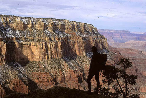 Silhouette of a hiker against the canyon walls, South Kaibab Trail, Grand Canyon National Park.