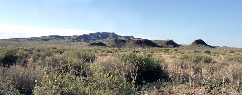 A panoramic shot of the Little San Pasqual Wilderness Unit. The area is marked by hills and mounds and shrubs.