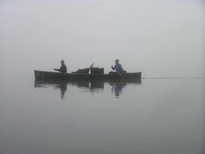Wilderness Rangers paddling to work in the fog.