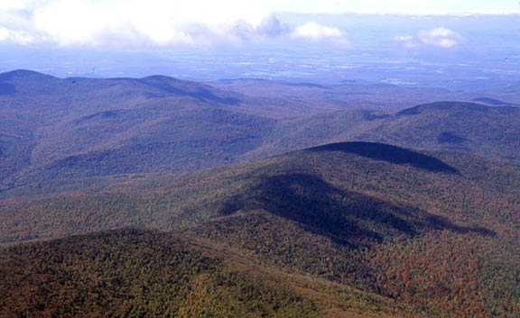 An aerial view of Romance Mountain in autumn on a sunny day.