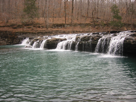 In autumn, water cascades over bluffs, creating a small but striking waterfall.
