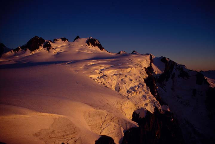 Sunset on the snow-covered Mt. Olympus summit.