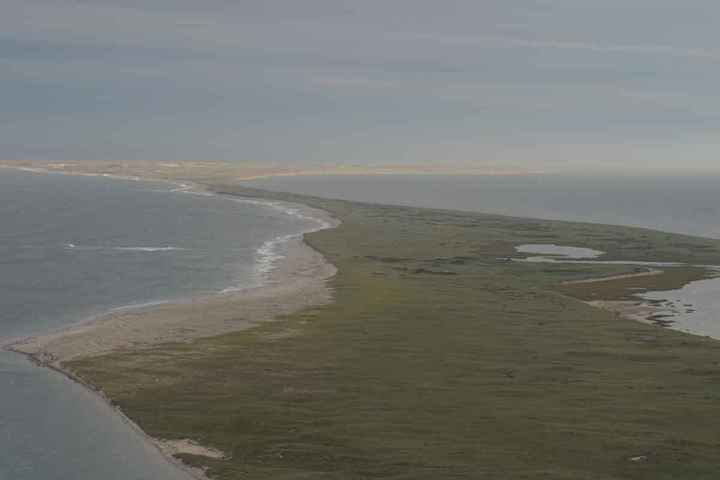 An aerial shot of South Monomoy which is a peninsula jutting into the ocean.