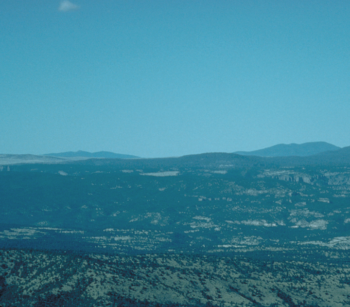 An aerial shot reveals relatively flat ground and a few low sweeping hills beyond.