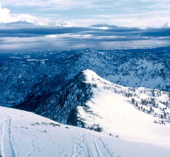 A photo from atop a mountain peak looking north in the Selway-Bitterroot Wilderness in winter.