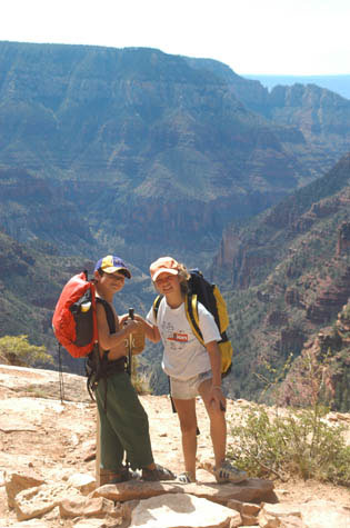 Two children pose in front of the Grand Canyon on the North Kaibab Trail.