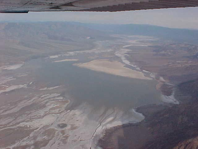 This is another aerial shot of the Death Valley Wilderness, where a lake sprawls over the flatland.