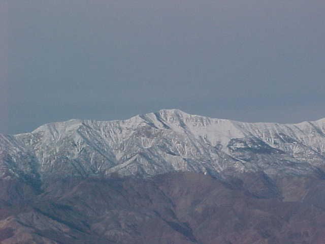 A rippled mountain range topped with snow.