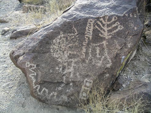 Ancient drawings on a desert rock.