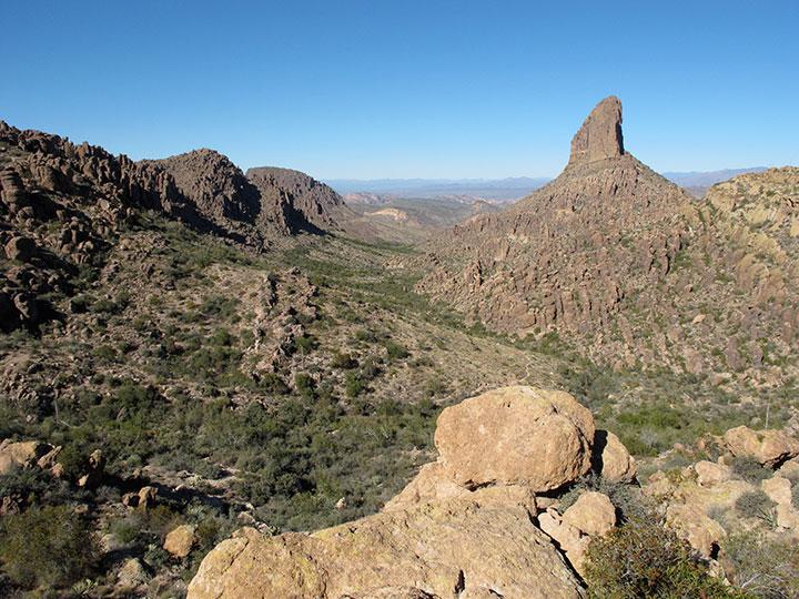 A sharp rocky point juts above a rocky landscape