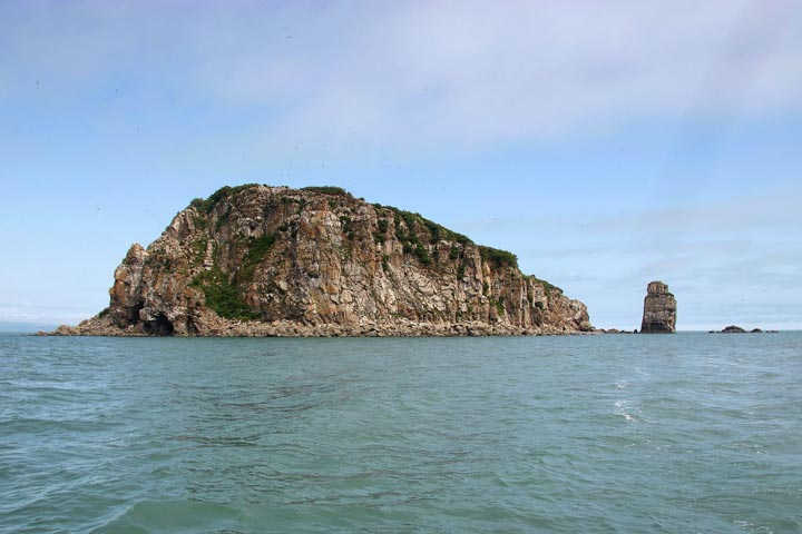 Duck Island rises out of the blue-green waters of Tuxedi Bay.