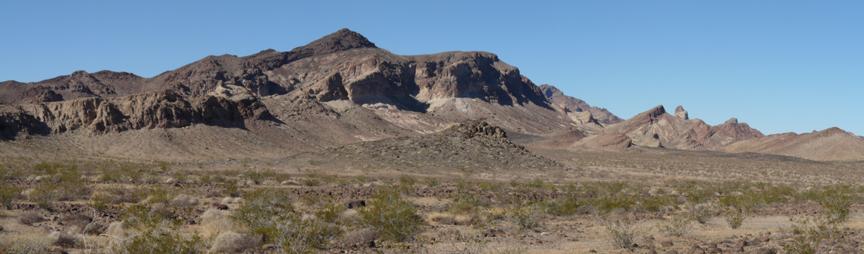 A mountain range over a desert.