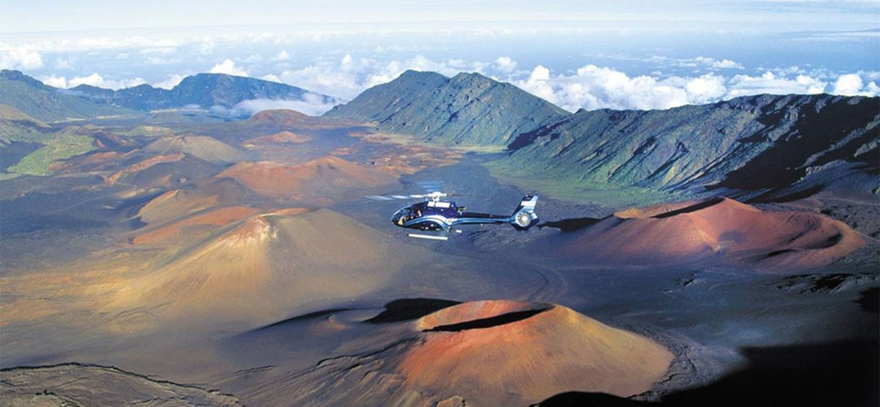 Helicopter flying over volcanic craters