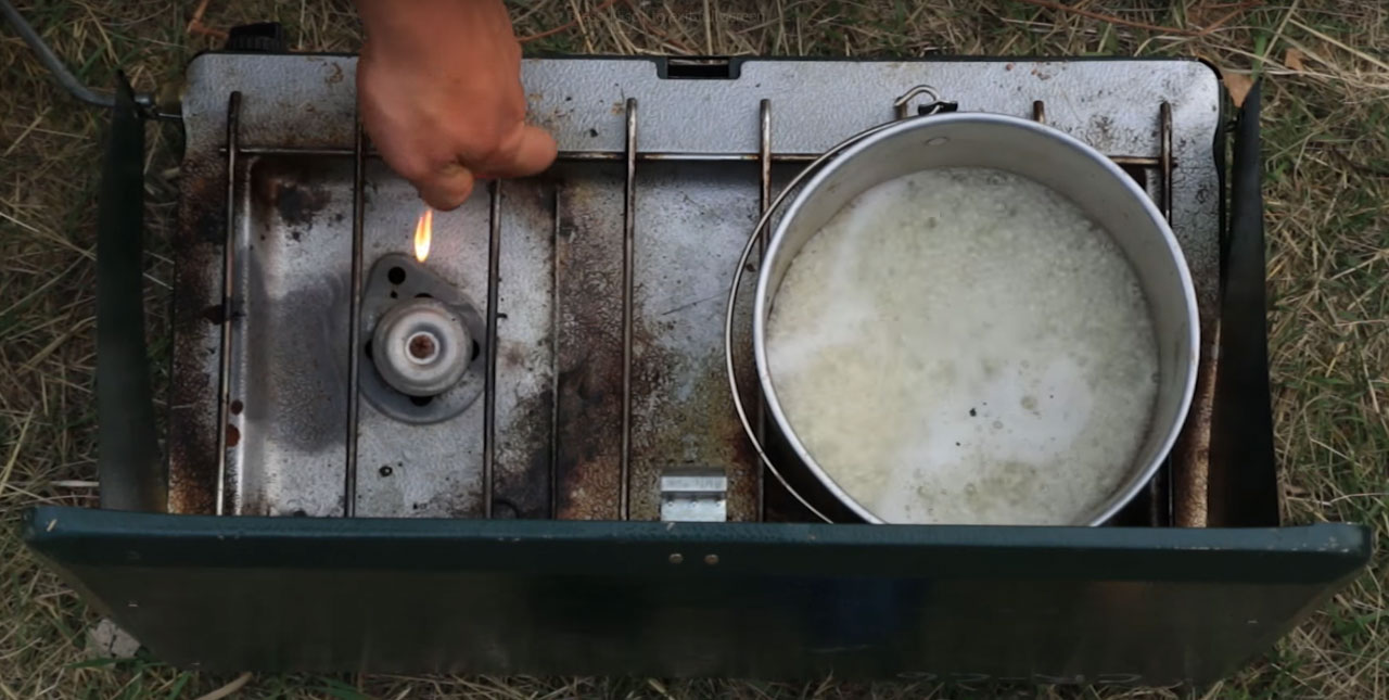 Camp stove being lit
