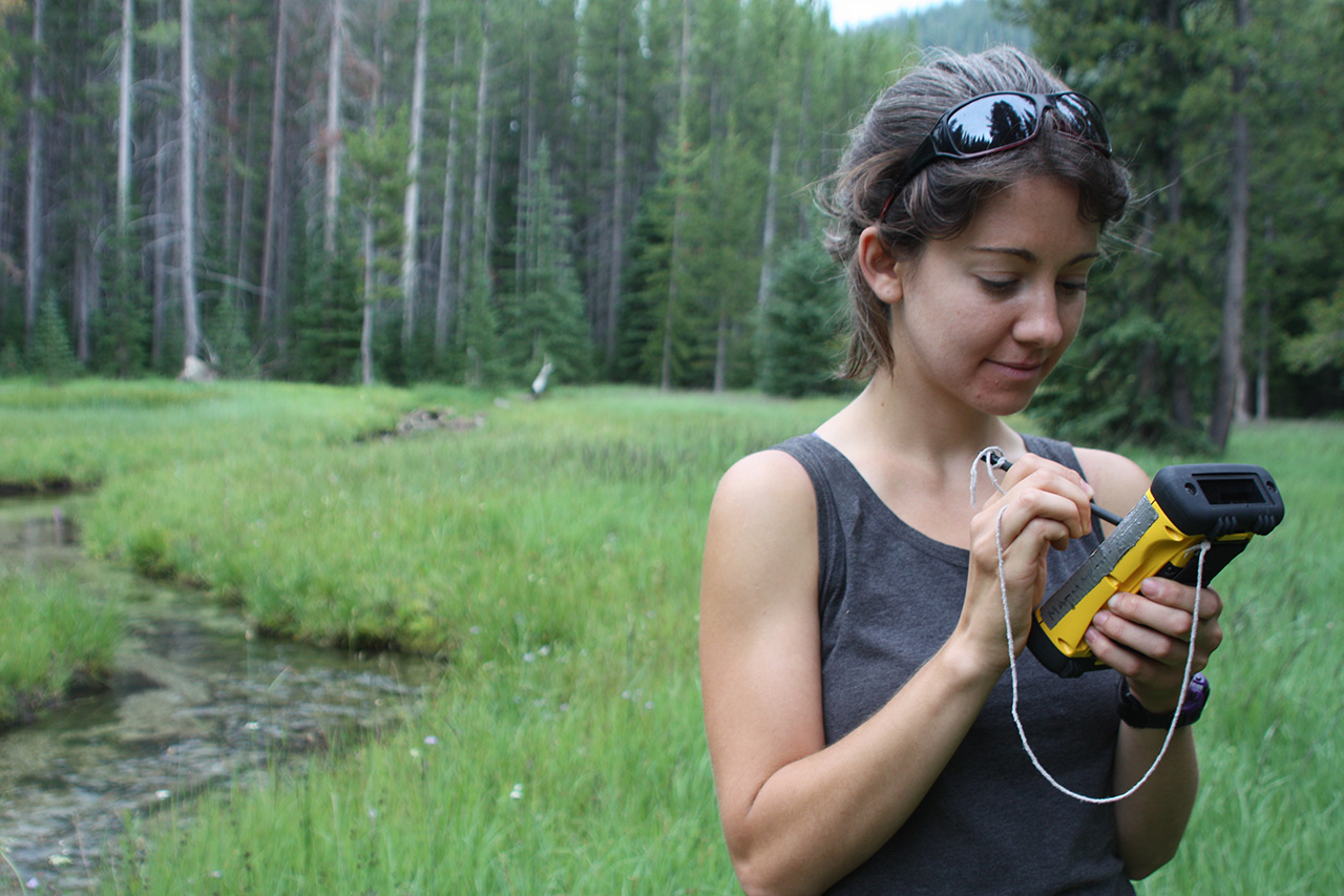 Woman mapping weeds with GPS unit